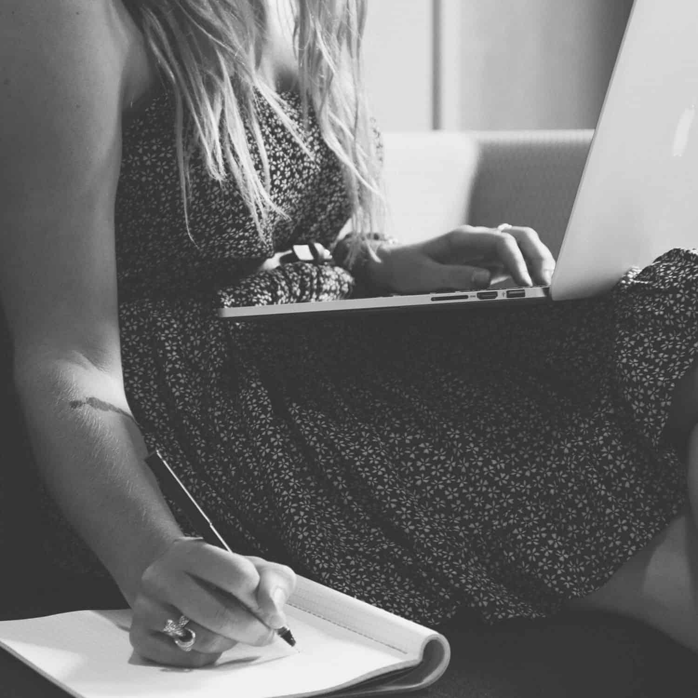Woman laptop taking notes